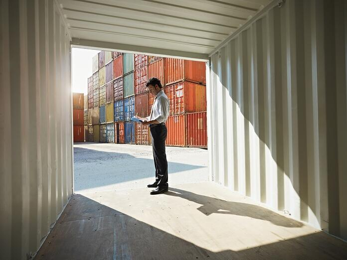 Business man with shipping containers.jpg