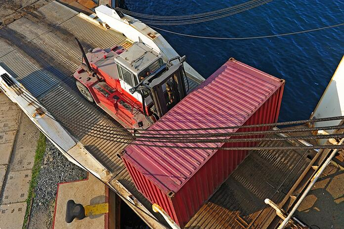 Loader with container entering ship.jpg