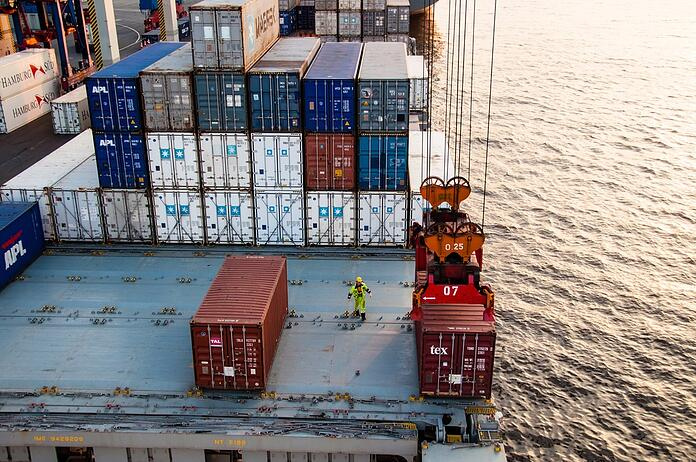 Worker assisting container uploading at dock.jpg